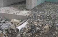 Drainage tile during new construction - partially blocked with rock.